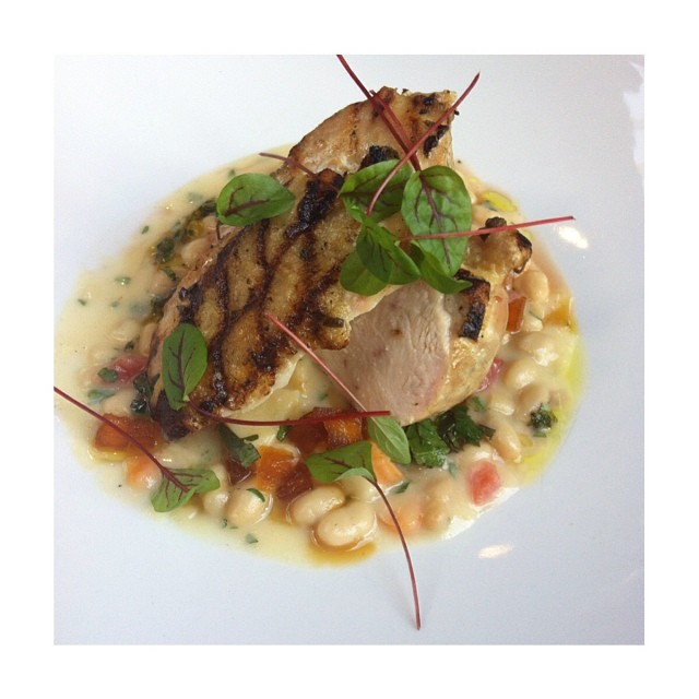 Bymark Roasted Chicken Breast with white beans, parsnip, oregano tapenade and brandy braised apple. Photo by @diningdianna